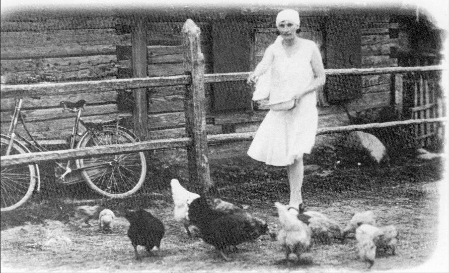 Feeding chickens in a garden of a Shadova  house